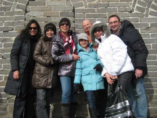 My sister, her family, my daughter and a couple with us enjoying the tour. On top of the Great Wall, China March 2010.