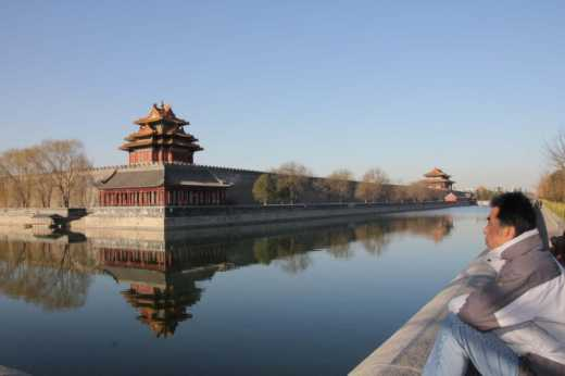 Chinese man looking at the Forbidden City.