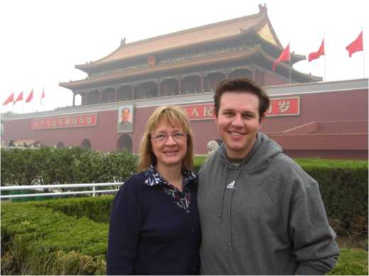 My mom and I before the entrance to the Forbidden City.