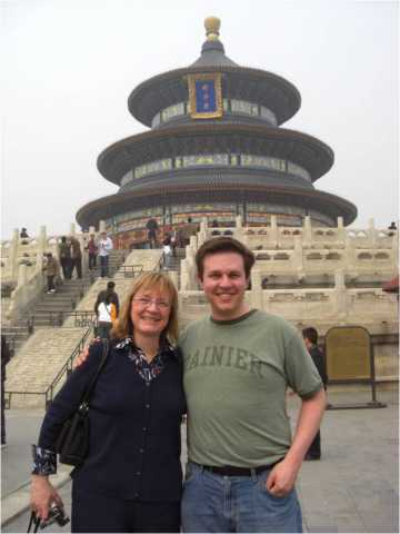 My mom and I in front of the Temple of Heaven.