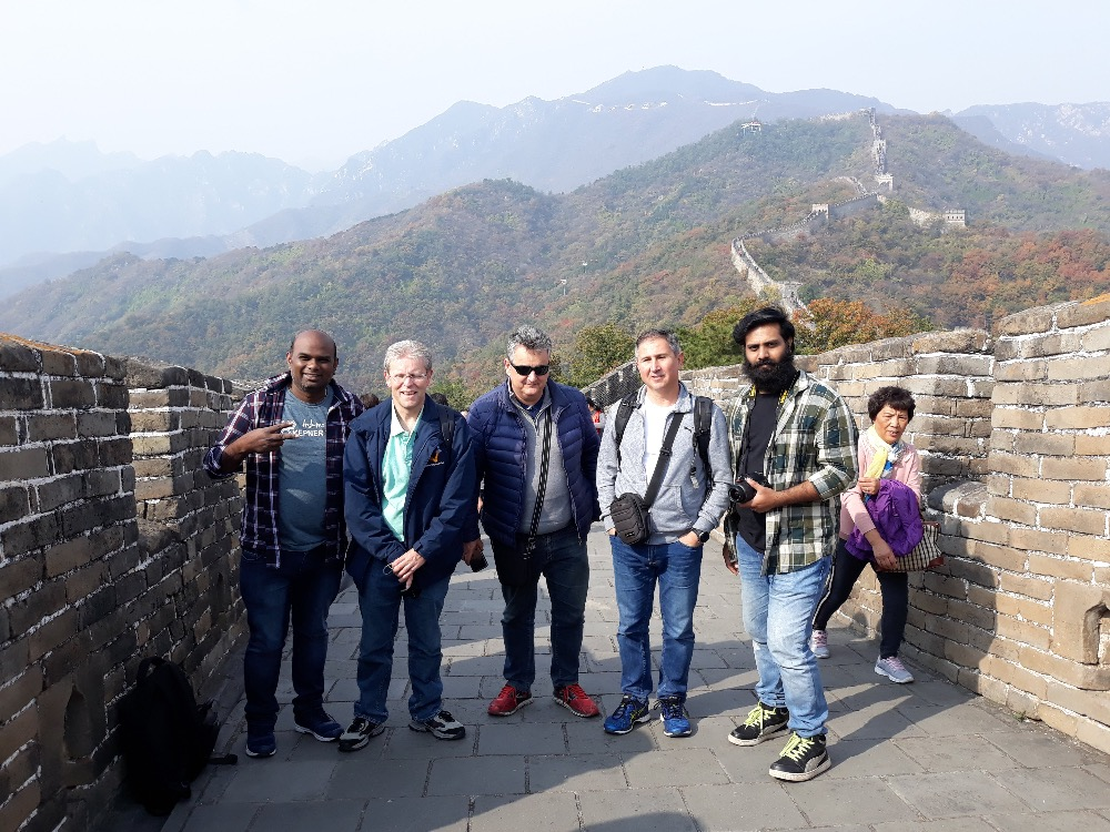 With the entire team on great wall of China